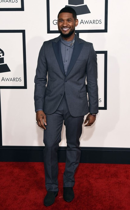 Usher Great looking l suit and Louis Leeman shoes.